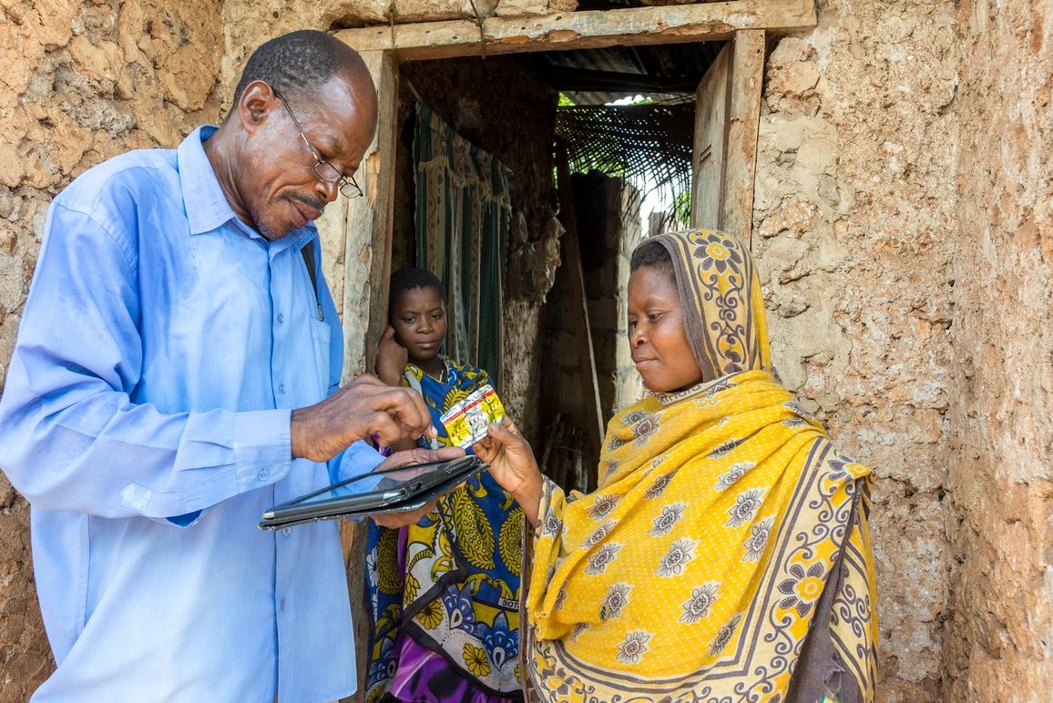 A district malaria officer in Zanzibar tests a household member for malaria. Coconut Surveillance, and mHealth application developed by RTI, is being used in an active effort to eradicate the disease from Zanzibar.